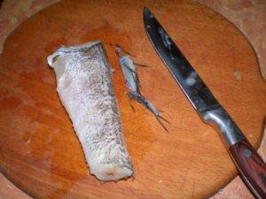 Срезание плавников с рыбы